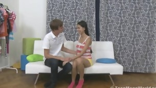 Appealing teen rides a cock on the top of a white couch