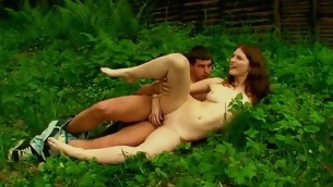 Nasty hottie performs sex on the grass with her agile partner